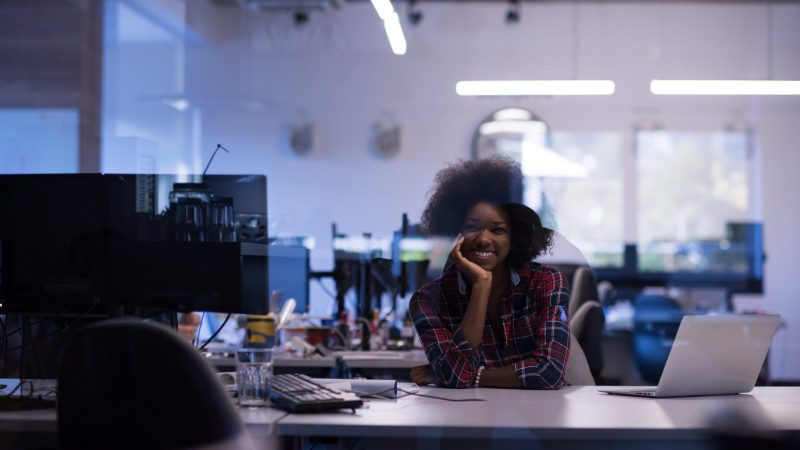 young-black-woman-at-her-workplace-in-modern-PHBNXLU