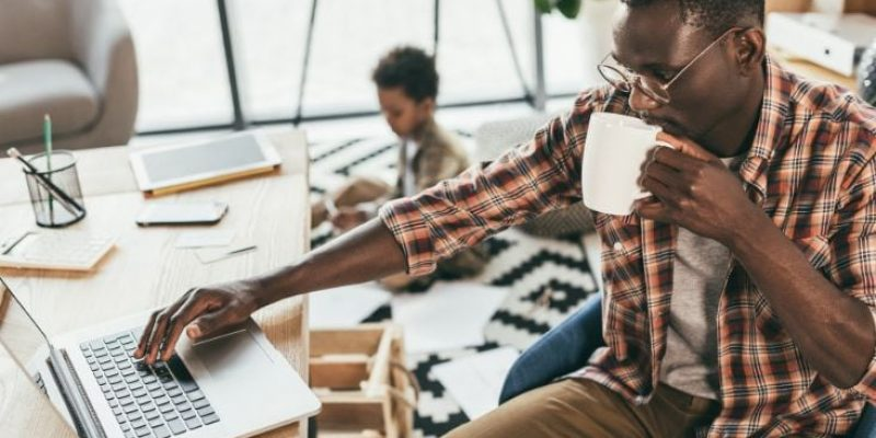 Canva-african-american-father-and-son-in-office-1